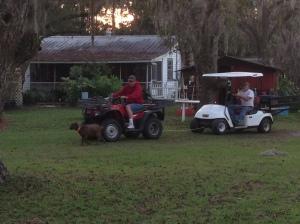 Neighbor pulling Marshall's dead Gulf Cart